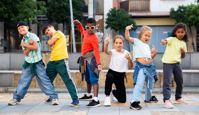 smiling-girls-boys-hip-hop-dancers-doing-dance-workout-open-air-group-class-kids-posing-outdoor-d.jpg